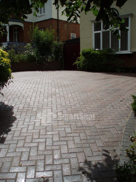 Driveway after cleaning, re-sanding and sealing